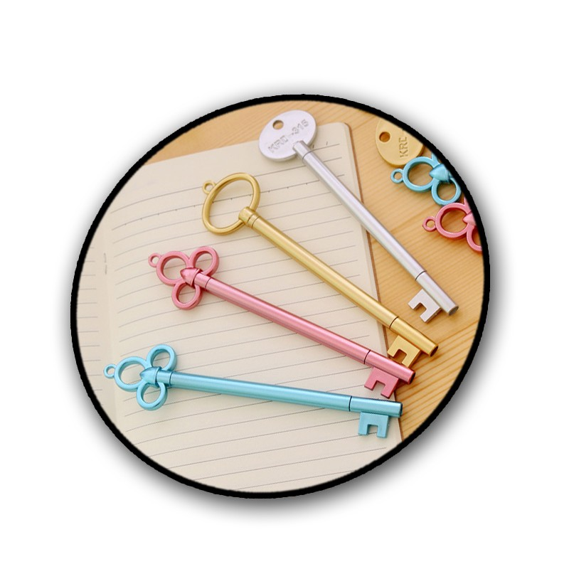 Gold colored pen (key shape)